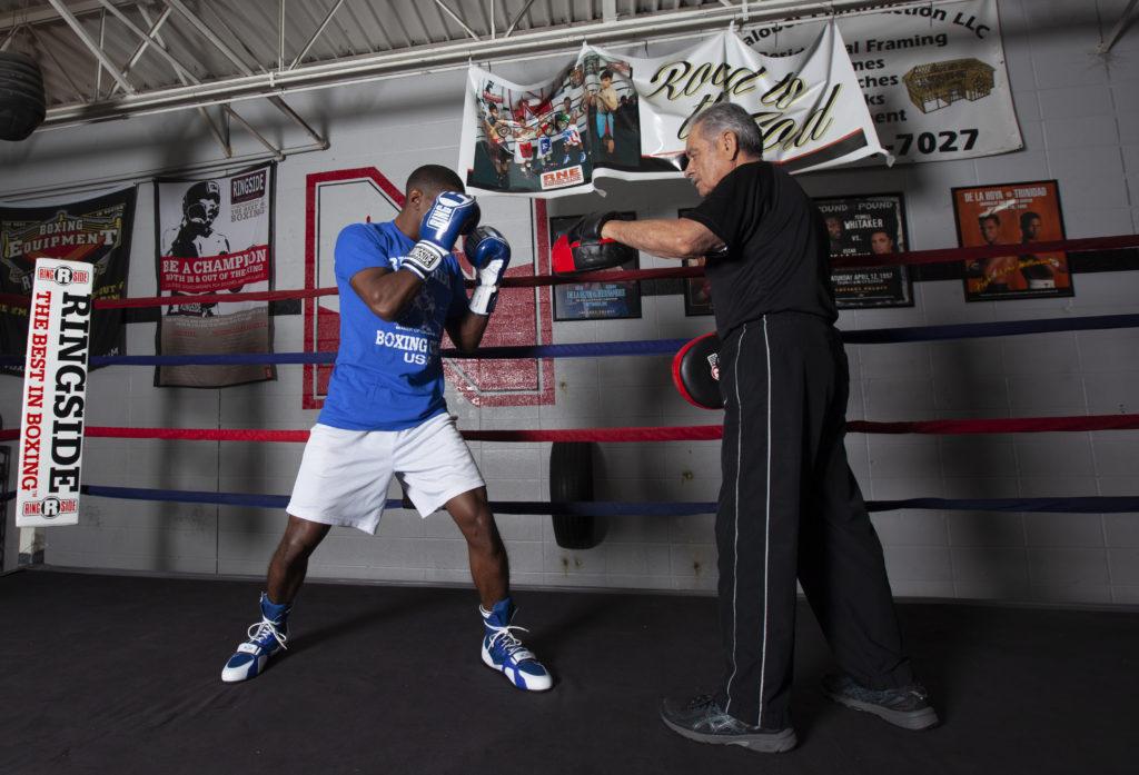 Boxer in ready stance doing mitt work