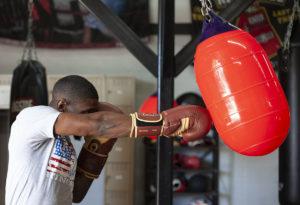 hitting the water bag next to open garage door, boxing training